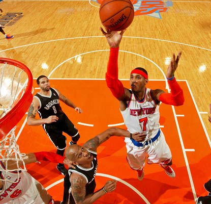 Carmelo Anthony returns to the Knicks lineup and drops 31 on the Nets in a comfortable victory.  (Getty Images)