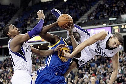 Francisco Garcia goes sidways as Kings teammate Jason Thompson tries to stop Warriors forward Draymond Green.  (US Presswire)