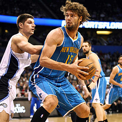 Hornets center Robin Lopez (right), who scores a season-high 29 points, tries to drive around Magic center Nikola Vucevic. (US Presswire)