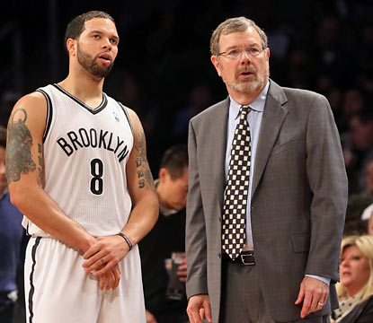 Deron Williams comes through with 19 points despite a wrist injury as P.J. Carlesimo comes away victorious in his debut. (Getty Images)