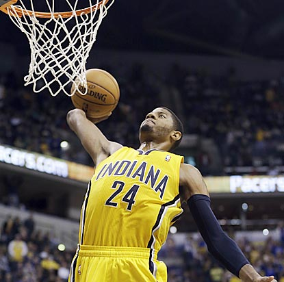 Pacers All-Star candidate Paul George dunks after making a steal at midcourt midway through the fourth quarter.  (AP)