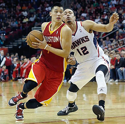 Jeremy Lin, shown blowing by John Jenkins here, contributes 16 points and eight assists for host Houston.  (Getty Images)