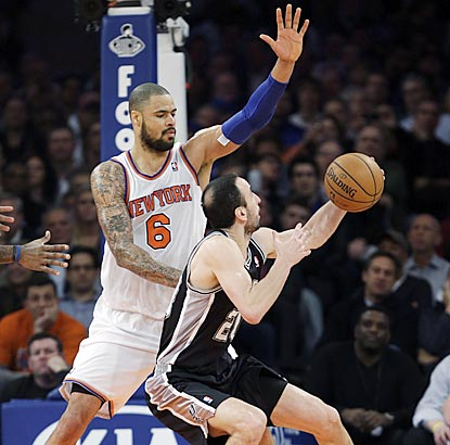 Tyson Chandler and the Knicks stand tall against Manu Ginobili and the Spurs' league-best offense.  (AP)
