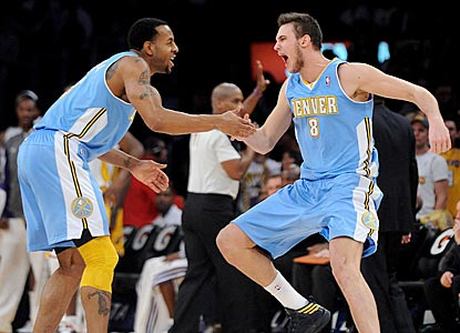 A jubilant Danilo Gallinari (right) celebrates with Andre Iguodala after hitting a dagger 3-pointer late in the fourth quarter. (US Presswire)