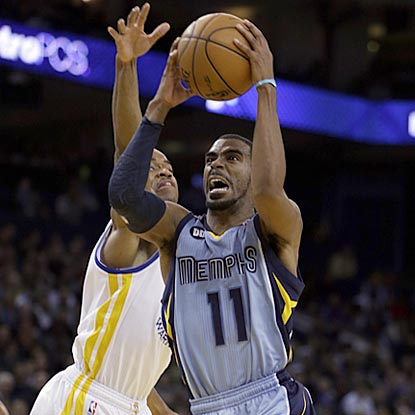 Memphis' Mike Conley (11), who winds up with 16 points, drives by Golden State's Jarrett Jack during the second half.  (AP)