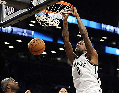 Brooklyn's Andray Blatche flushes a dunk for two of his 15 points against Phoenix. Blatche also grabs eight boards. (AP)