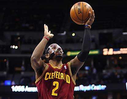 Cavaliers guard Kyrie Irving, battling an illness, scores a game-high 28 points, but Cleveland blows a fourth-quarter lead. (US Presswire)