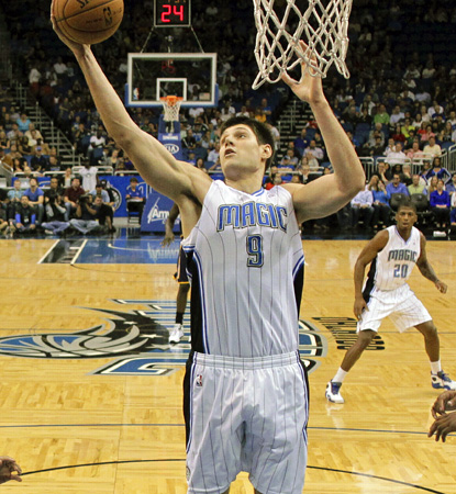 The Magic's Nikola Vucevic, who scores 16 points in the win over the Pacers, grabs one of his 15 rebounds. (AP)