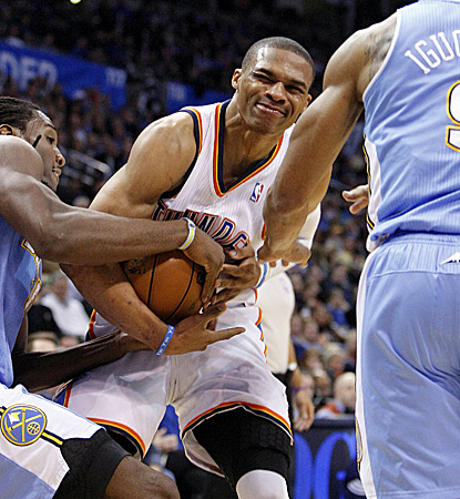 Russell Westbrook, who fights for possession of the ball, scores half of his 32 points in the opening quarter. (AP)