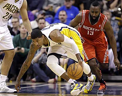 Indiana's Paul George grabs a steal from Houston's James Harden on his way to 31 points. (AP)