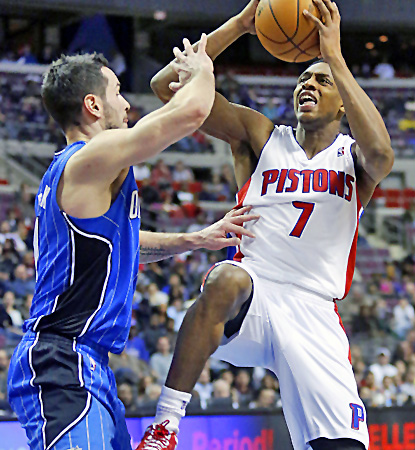 Brandon Knight (right) scores 18 points to lead the Pistons past the Magic. (AP)