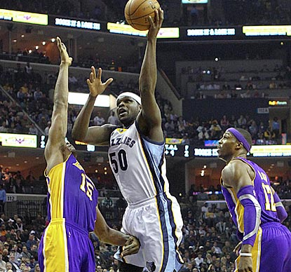 Zach Randolph drives between Metta World Peace (left) and Dwight Howard during another double-double performance.  (US Presswire)