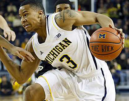 Michigan guard Trey Burke scores 15 points and dishes out 8 assists in the Wolverines win over Purdue. (US Presswire)