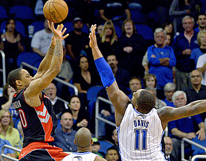 DeMar DeRozan leads Toronto with 22 points, including this game-winner over the Magic's Glen Davis. (AP)