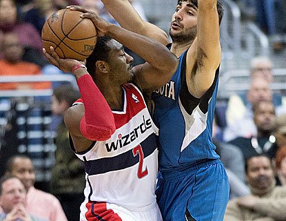 Washington's John Wall scores 14 points to go with  five assists in his first start of the season. (Getty Images)