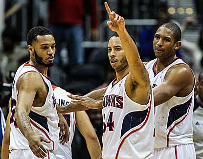 Devin Harris, who scores 14 points, celebrates Atlanta's come-from-behind, double-OT win over Boston. (US Presswire)