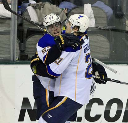 David Perron (left) celebrates one of his two goals -- his first of the season -- to pace the Blues offense in Dallas.  (AP)