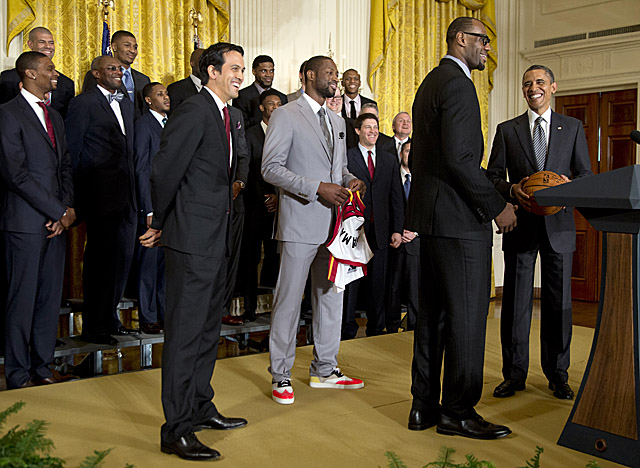 Obama tells LeBron, 'It's your world' when King James asks to say a few words Monday. (AP)