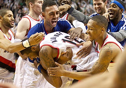 LaMarcus Aldridge gets surrounded by his teammates after finishing off a 29-point performance with a game-ending basket.  (US Presswire)