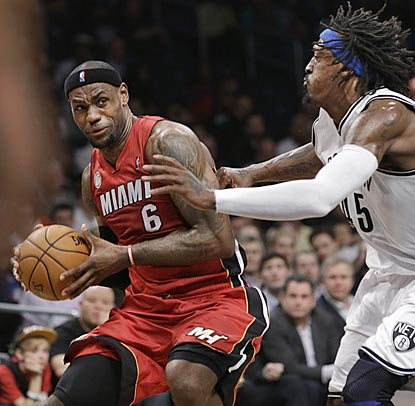 Gerald Wallace can't stop LeBron James, whose near-triple-double helps Miami beat Brooklyn for the 13th consecutive time.  (AP)