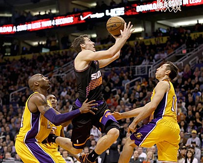 Kobe Bryant and Steve Nash (right) watch Suns guard Goran Dragic drive to the basket during the second half.  (US Presswire)