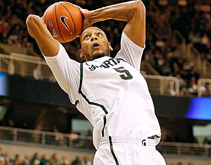 Michigan State center Adreian Payne dunks home 2 of his 8 points. He also grabs 6 rebounds against Illinois. (Getty Images)