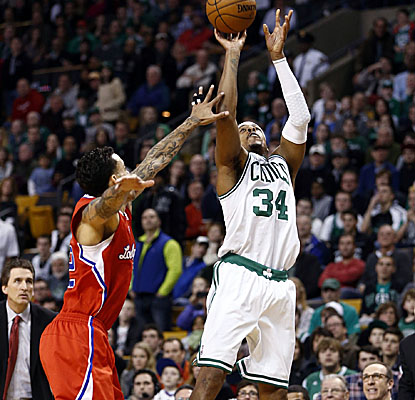 An off-balance Paul Pierce lets fly with less than 3 seconds left and sinks the trey to help put away the Clippers in Boston. (US Presswire)