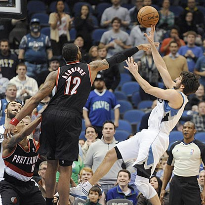 Portland's LaMarcus Aldridge blocks Ricky Rubio's potential game-tying shot in the final seconds.  (AP)
