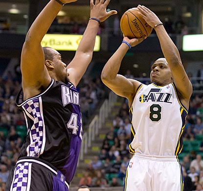 Randy Foye, who leads Utah with 20 points, attempts a 3-point shot over Sacramento's Chuck Hayes during the second half.  (US Presswire)