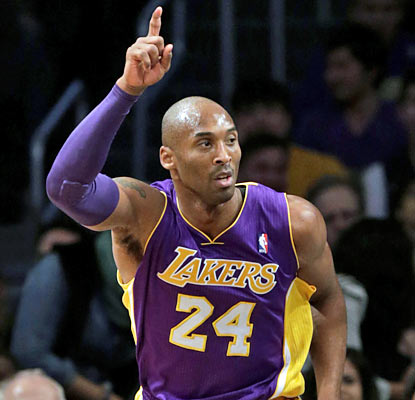 Kobe (21 points) and the Lakers close out the game strong to finish on top once again against the Nets. (AP)