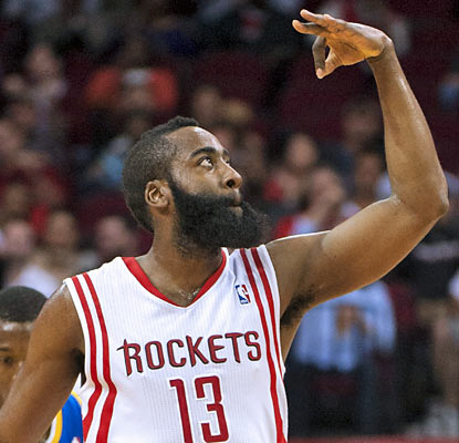 James Harden (18 points) knocks down four of the Rockets' franchise-best 23 threes. (AP)