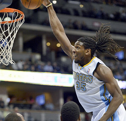 Kenneth Faried, who finishes with 13 points and 10 rebounds, throws down a dunk against the Bucks. (Getty Images)