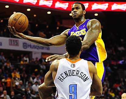 Earl Clark goes up for two of his 17 points, while also grabbing 10 boards in LA's comeback win. (US Presswire)