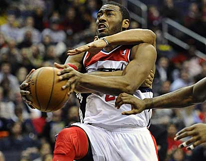 John Wall (15 points, 9 assists) will head to the line after being fouled by Keith Bogans. (US Presswire)