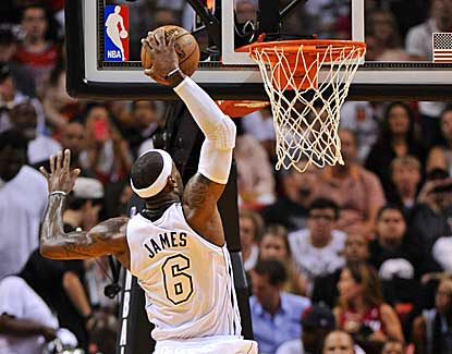 LeBron James elevates for the jam on his way to 32 points in Miami's win over the Lakers. (US Presswire)