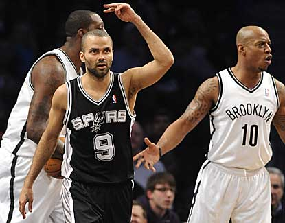 Tony Parker scores 29 points with 11 assists to lead the Spurs to victory without Tim Duncan or Manu Ginobili. (AP)