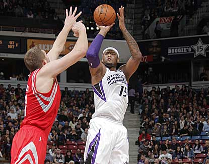 Sacramento's DeMarcus Cousins puts up a jumper en route to 20 points in the Kings' win over Houston. (Getty Images)