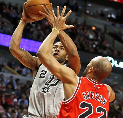 Kawhi Leonard steps up for the hobbled Spurs with a career-high 26 points and plays a game-high 44 minutes. (AP)