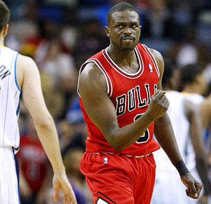 Bulls forward Luol Deng (20 points) helps put away the Hornets with a jumper with 44.8 seconds left in the game. (AP)