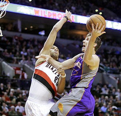 Will he shoot or will he pass? Goran Dragic provides a career-high 18 assists to go along with his 16 points. (AP)