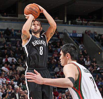 The Nets get 23 points and eight assists from Deron Williams, who finishes 7 of 16 from the field. (Getty Images)