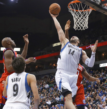 Nikola Pekovic, who scores 27 points, goes up for one of his 18 rebounds against the 76ers. (AP)