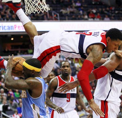 Bradley Beal takes a hard fall late but ends the game with 17 points and a career-high 12 rebounds.  (USA Today Sports)