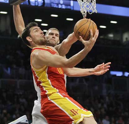 Carlos Delfino scores 22 points and the Rockets beat the Nets for the 13th straight time.  (AP)