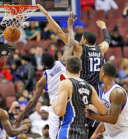 Orlando's Tobias Harris (right) dunks on Philadelphia's Dorell Wright during the Magic's win over the Sixers. (AP)