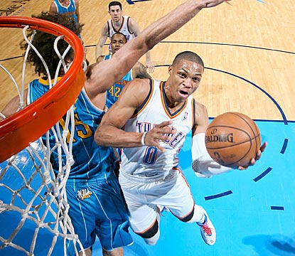 Oklahoma City's Russell Westbrook finds his way around New Orleans' Robin Lopez en route to a 29-point outing.  (Getty Images)
