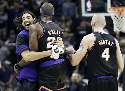 Jermaine O'Neal, who has a big game off the bench, celebrates the victory with Luis Scola (left) and Marcin Gortat.  (AP)