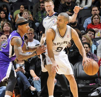 Tony Parker has 13 points and seven assists before spraining his left ankle and leaving the game.  (Getty Images)