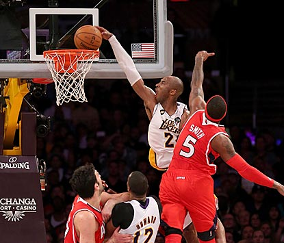 Kobe Bryant shows he still has some hops at age 34 with this epic dunk over Josh Smith late in the fourth quarter.  (Getty Images)