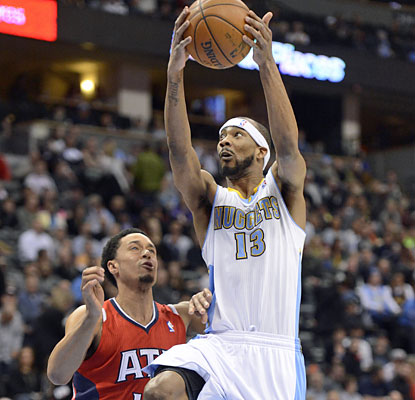 Corey Brewer (22 points) and the Nuggets match Miami for the best home record in the NBA at 26-3. (Getty Images)